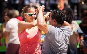 Couple dancing on dance floor at Festival